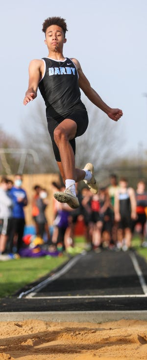 Alex Smith won the high jump and long jump to help the Hilliard Darby boys team capture the Division I regional title May 28 at Pickerington North.