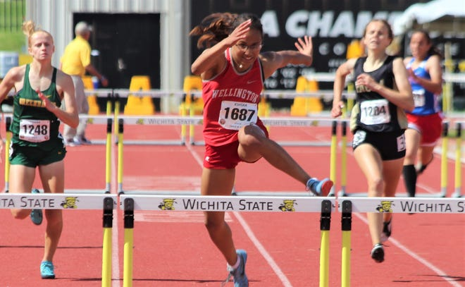 Annalisa Cullens finishing the 300-meter hurdles, claiming her second gold medal at the KSHSAA State Track and Field Championships