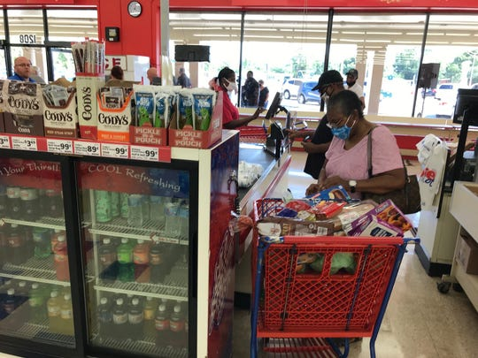 Shoppers line up at the Save a Lot grocery store on Dixon Boulevard.  The store reopened on May 28 after closing for two months due to financial issues exacerbated by COVID-19 and supply issues.