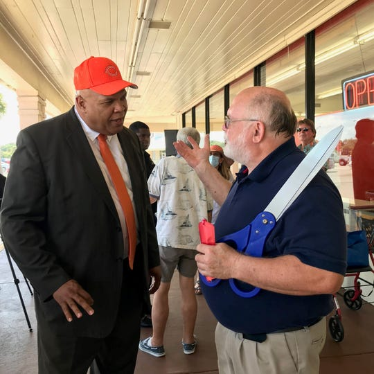 Cocoa Mayor Mike Blake, left, and Mike Medearis, owner of Save a Lot grocery store on Dixon Boulevard, greet each other as the store reopens, which closed on March 27 May 28.