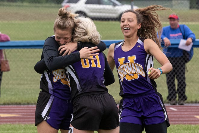Paris DeBord, Karlee Renner, and Arielle Pelletier celebrate after learning they qualified for the state track and field tournament in the girls 4x100 meter relay that will be held in Pickerington High School North at the Division II Regional tournament on Saturday, May 29, 2021, in Chillicothe, Ohio.