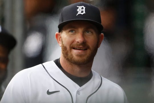 Detroit Tigers exit fielder Robbie Grossman (8) smiles at the dugout before a game against the New York Yankees at Comerica Park on May 28, 2021.