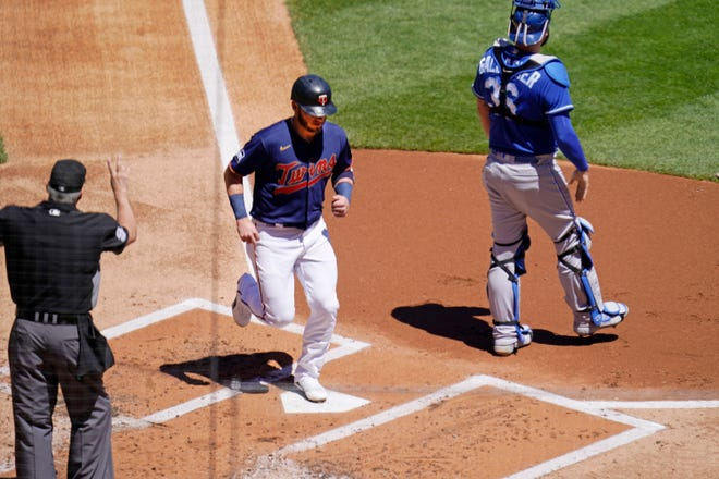Minnesota Twins' Josh Donaldson scores on a ground-rule double by Nelson Cruz in the first inning of a baseball game against the Kansas City Royals, Saturday, May 29, 2021, in Minneapolis. It was the 2 millionth run scored in Major League Baseball history, according to Elias Sports Bureau.