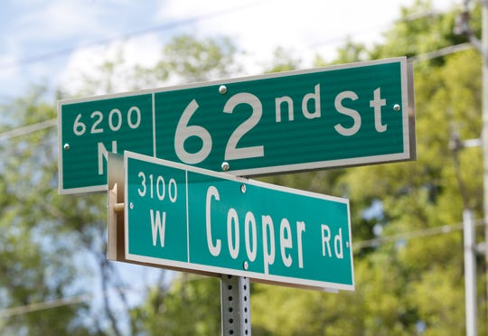 IMPD is investigating after a shooting and subsequent pursuit left an officer wounded on Saturday, May 29, 2021, near the intersection of N. 62nd St. and Cooper Rd in Indianapolis.