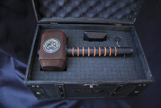 A ceremonial gavel created for Farmington Mayor Nate Duckett and inspired by Thor's hammer rests in its case.