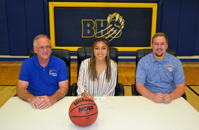 Bloomfield's Madison Bedonie signs her national letter of intent on Friday, May 28, 2021, to continue her basketball career at NAIA Benedictine University at Mesa.