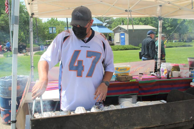 Jeff Day of Johnny's Jumbo Turkey Legs works the grill in Berg Park in Farmington on May 29. Food vendors are working the inaugural Animas River Jam in Animas and Berg parks on May 29 and 30.