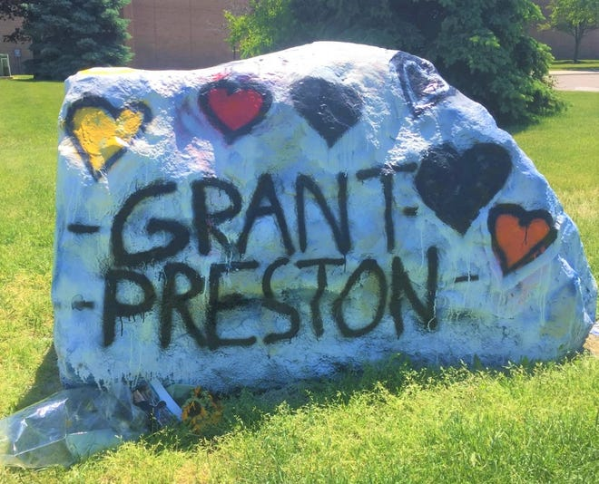 The rock outside Salem High School is serving as a temporary memorial to Plymouth-Canton students Grant Waitz and Preston Bell, both of whom died by suicide in 2021.