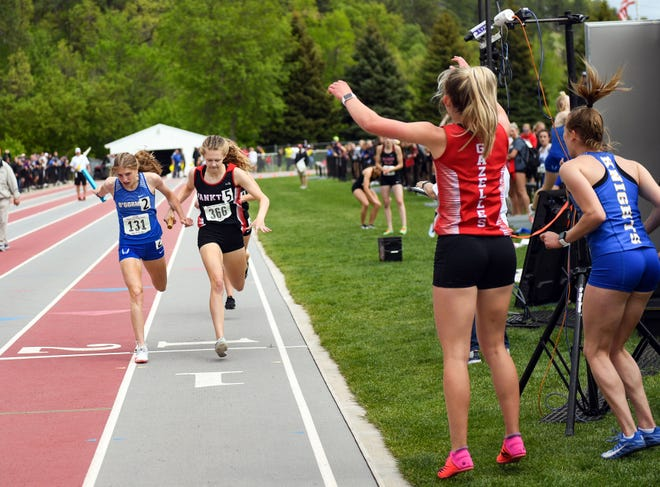 Yankton's Annika Gordon, right, narrowly beats O'Gorman's Mahli Abdouch across the finish line of the 4x400 race at the State Track and Field Meet on Saturday, May 29, 2021 at Woodle Field in Sturgis, South Dakota. Brandon Valley's Emily Van Roekel is directly behind, finishing third.