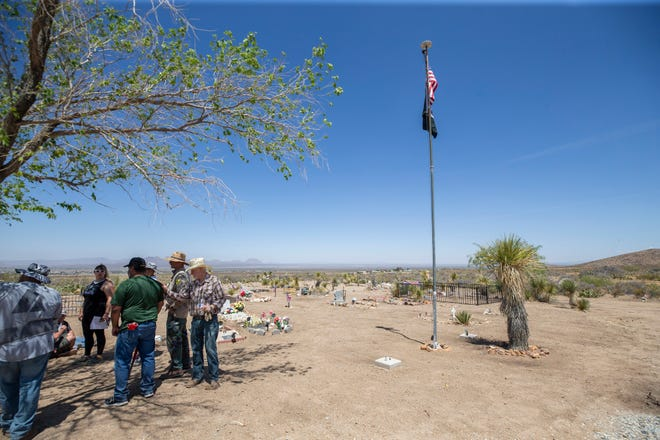 Veterans help clean Slumbering Mountain Cemetery in Organ, N.M., on May 29, 2021 as part of the Third Judicial District Court's Veterans Treatment Court program. The strictly regimented program helps rehabilitate veterans.
