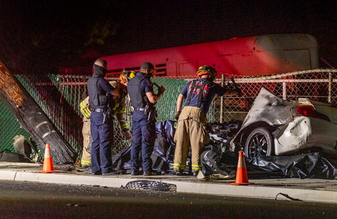 Visalia Police and Fire investigate a single car collision on Walnut Avenue just west of Linwood on Saturday, May 29, 2021. Two people were westbound in a 4-door sedan about 1 a.m. when it left the roadway, collided with a utility pole and burst into flames. Both occupants died in the car. Police said excessive speed was a factor in the collision. The street will be closed during the investigation and while crews repair damage.