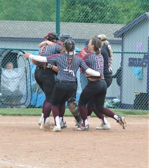 Several John Glenn players celebrate the team's state final four berth after Saturday's 4-3 win over Heath in the Division II regional final at Pickerington Central.