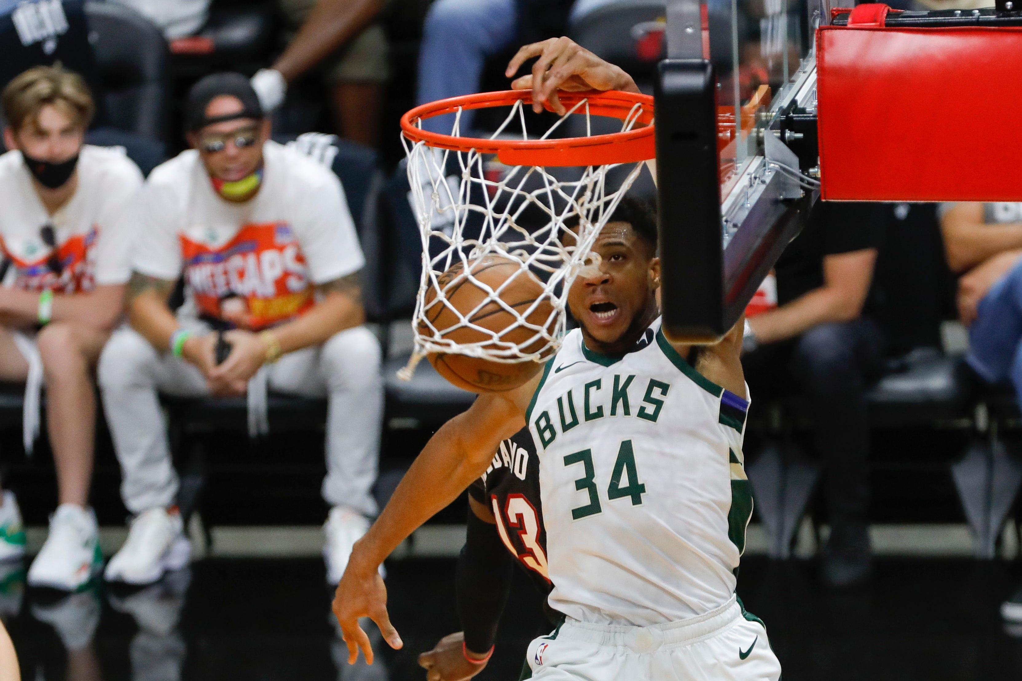Milwaukee Bucks sweep Miami Heat to advance in NBA playoffs; Giannis Antetokounmpo posts triple-double