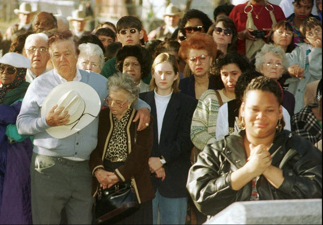 Admirers pay their respects to Barbara Jordan during the interment ceremony at the Austin State Cemetery in 1996.