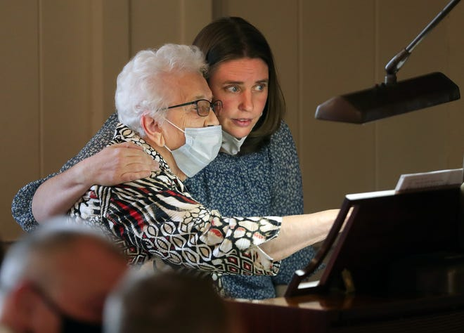 Miriam Hendershott, the 93-year-old organist for Lexington United Methodist Church, shares a moment with Rev. Rebecca Evanoff as she warms up before the final service at her church near Alliance.
