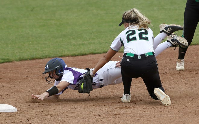 Triway base runner Makayla Greene, left, is tagged out by West Branch's Sydney Mercer (22) on the throw from home plate during a steal attempt during Division II regional final softball action at Akron Firestone Stadium Sunday, May 30, 2021.