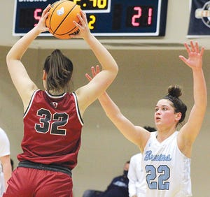 IMPORTANT NOD: Bartlesville High junior Kate Grongian, right, received a spot in the honorable mention list of a Tulsa newspaper's list of the area's top girls basketball players for 2020-21.