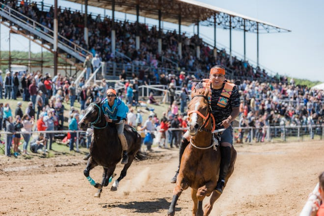 Horses reach speeds of over 40 mph as they race around the track on Saturday during the Indian Relay Horse Racing International Championships at the Osage County Fairgrounds in Pawhuska.
