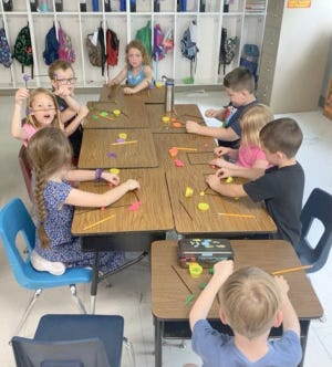Mrs. Amy Rapp's first graders make rectangles and triangles using playdough and straws to learn about sides and vertices.