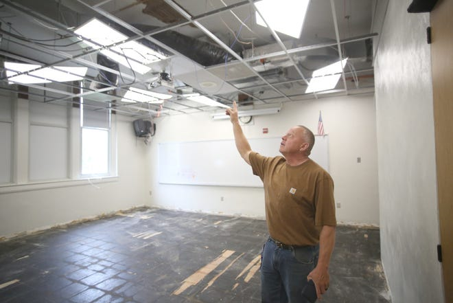 Boonville Assistant Superintendent Fred Smith points to the ceiling in one of the rooms being renovated at Laura Speed Elliott Middle School this summer as part of the Phase 2 project.
