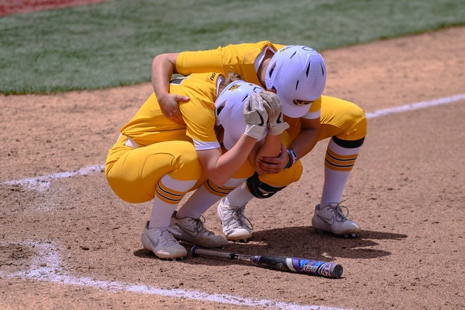 Mizzou's Kim Wert (17) consoles catcher Hatti Moore (31) after she made the third and final out in the seventh inning against James Madison Sunday afternoon at Mizzou Softball Stadium. James Madison advanced to the Women's College World Series with the 7-2 win over the Tigers.