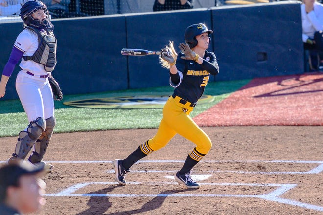 Mizzou's Cayla Kessinger (33) watches the arc of the first of two home runs she hit Saturday evening against James Madison in Game 2 of super regionals at Mizzou Softball Stadium.