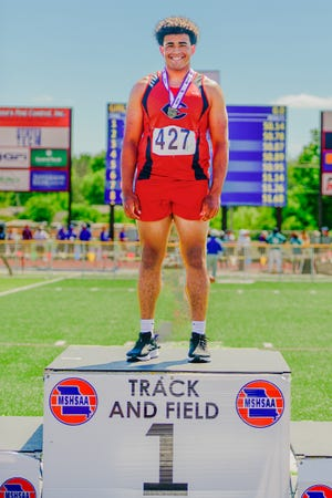 """Chillicothe High School junior Damarcus Kelow stands on the top step of the medals stand after receiving his medal as champion of Missouri's Class 3 track-and-field state meet discus throw Saturday, May 29. Kelow took the title with a best throw of 162'8"""", more than seven feet longer than his nearest competition. He narrowly missed (1/4-inch) also medaling in the shot put"""