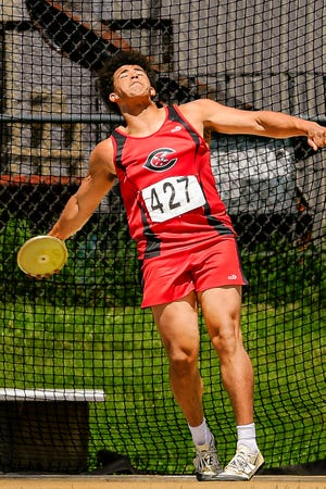 """Chillicothe High School junior Damarcus Kelow nears the release point on one of his four attempts in the discus throw at the 2021 Missouri Class 3 track-and-field state championships at Jefferson City Saturday, May 29. On the third of his four attempts, the Hornet uncorked a throw of 162'8"""" which won him the state title."""