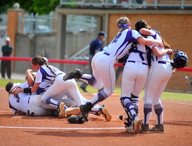 Triway celebrates after becoming the first team in program history to win a regional title.