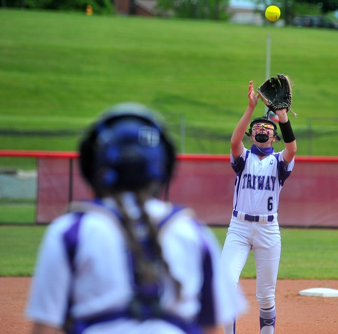 Carter Wachtel catches a fly ball with Maddie Fatzinger in the foreground.