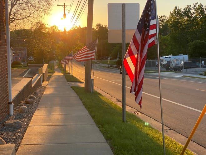 American flags distributed by the Kiwanis Club of Adrian flutter in the breeze along West Maple Avenue outside the Gurdjian Insurance Group Inc. office. Monday was celebrated as the Flag Day holiday, commemorating the adoption of the flag, dating back to June 14, 1777.