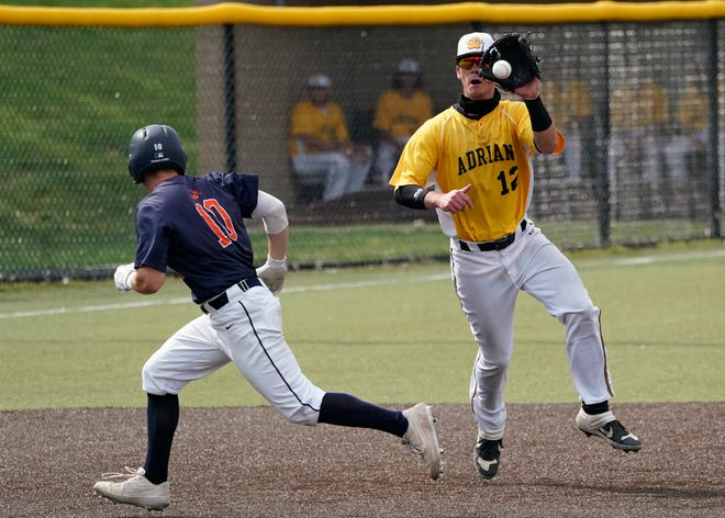 Adrian College's Sean O'Keefe fields a ground ball during the MIAA championship series against Hope.