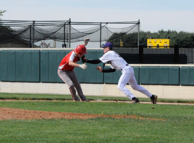 Blissfield first baseman Scott Jackson, right, tags out Temperance Bedford's Adam Reed in a rundown during the second inning of their nonconference contest Saturday at Blissfield.