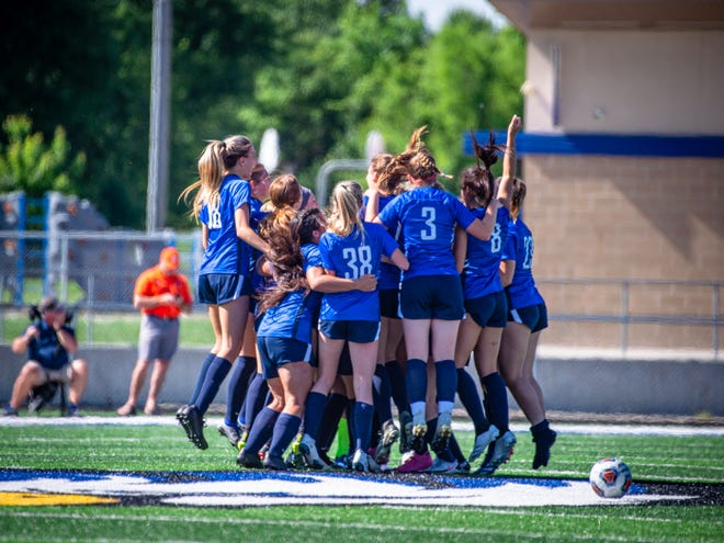 Grain Valley girls soccer players celebrate after defeating Platte County 2-0 Saturday in a Class 3 state quarterfinal to earn the program's first state final fourth berth.