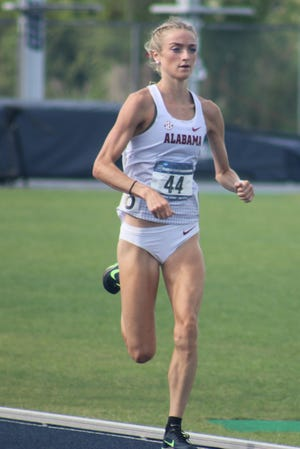 Alabama's Amaris Tyynismaa leads the field in the women's 1,500-meter run  at the NCAA East Preliminary track and field championships at the University of North Florida's Hodges Stadium on May 29, 2021. [Clayton Freeman/Florida Times-Union]