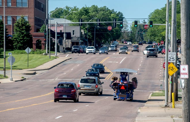 The Pedal Your Own Party pedal bus makes its way up Prospect Avenue on Saturday, May 29, in Peoria Heights.