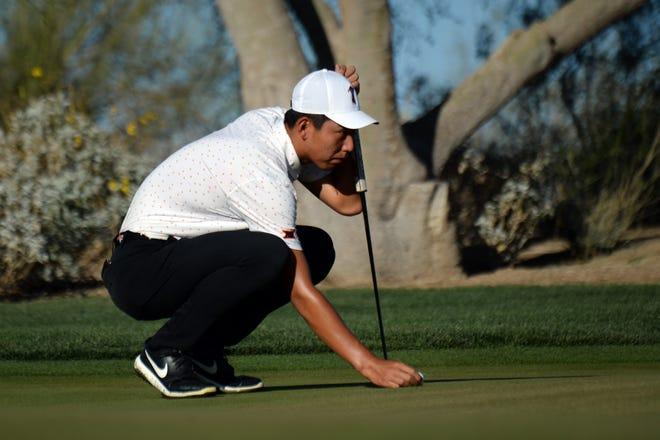 OSU University golfer Bo Jin lines up a putt on at the first green Sunday during the NCAA Men's Golf Championship in Scottsdale, Ariz. Jin is in the lead at 9-under, two shots up on Clemson's Turk Pettit.