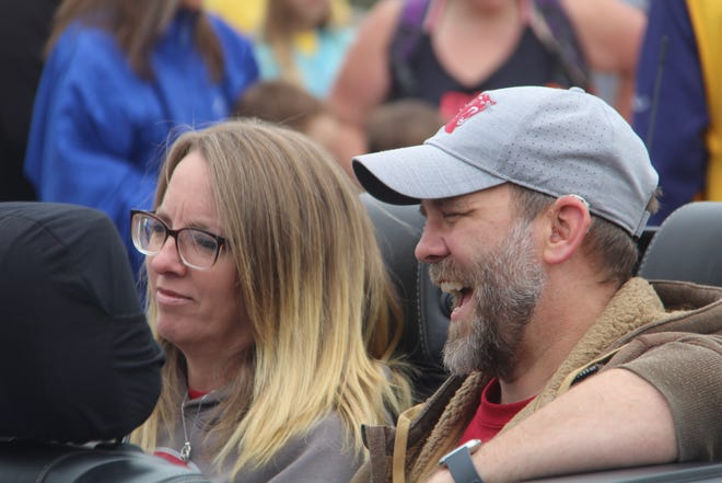 Parade marshals Pastor Jason Byers and his wife Brenda ride in the annual Big Heart Parade on Saturday, May 29.