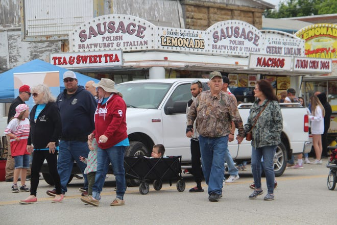 The town of Barnsdall and its guests celebrated Big Heart Day on Saturday. The annual Memorial Day Weekend event was not held in 2020, due to the COVID-19 pandemic. People attending the celebration are shown happily milling down Main Street.