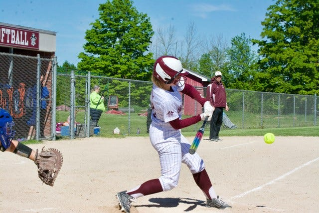 Charlevoix's Kylie Dorst swings into a pitch against Central Lake.