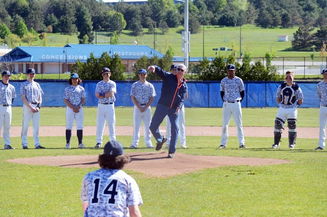 Dr. Jay DeGroot, who served in the U.S. Navy, throws out the opening pitch of the annual Petoskey Memorial Day Invite Saturday to his grandson and Northmen senior, Owen DeGroot (14).