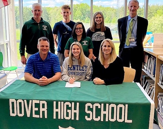 Dover High School senior Rachel Vitko will continue her volleyball career next year at Division II Bentley University. Vitko is seated with her parents, Tom and Sue. Dover High School volleyball coach Whitney Carrier is pictured in the middle, while standing in back row, from left, is Dover athletic director Peter Wotton, brother Ty Vitko, sister Tory Vitko and Dover principal Peter Driscoll.