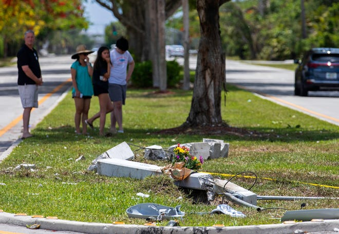 People gather at the site where five people were killed and five others seriously injured in a crash early Sunday morning in Boca Raton near the intersection of Camino Real and Sanibel Drive.