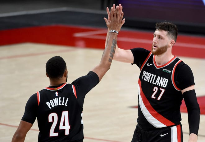 Portland's Norman Powell (24) celebrates with Jusuf Nurkic during the second of the Trail Blazers' 115-95 win over the Denver Nuggets on Saturday.