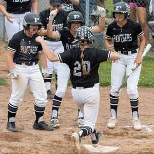 Perry's Missy Holzopfel comes home after hitting a thre-run homer in the fifth inning against New Philadelphia in the Division I regional final at Massillon on Sunday, May 30, 2021. (Bob Rossiter / Special to The Canton Repository)
