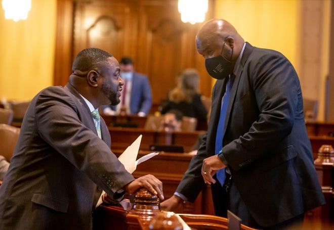 Illinois State Sen. Emil Jones III, D-Chicago, speaks with Sen. Elgie Sims Jr., D-Chicago, on the floor of the Illinois Senate at the Illinois State Capitol in Springfield Sunday.