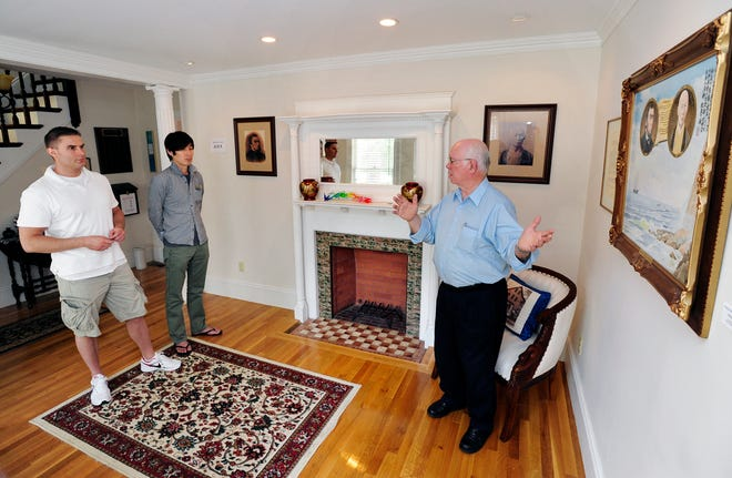 Gerry Rooney gives a tour of the Whitfield-Manjiro Friendship House in Fairhaven to two visitors in 2011.