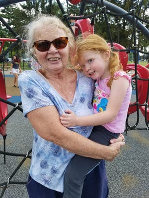 Kathy Piccolo of Sherrodsville said she will continue to wear a mask in congested areas such as the grocery store. She is shown with granddaughter Pepper Crumley, 4, at Dover City Park. NANCY MOLNAR/TIMES-REPORTER