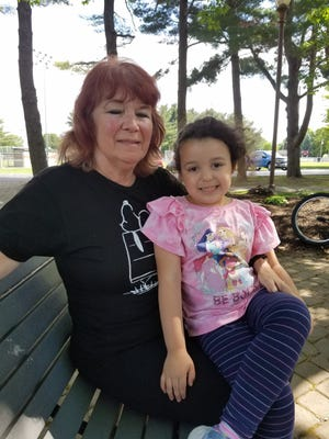 Diane Sulak of North Canton said she will continue to wear a mask sometimes because not everyone is getting vaccinated against COVID-19. She is shown with granddaughter Lilliana Bryan at Dover City Park. NANCY MOLNAR/TIMES-REPORTER