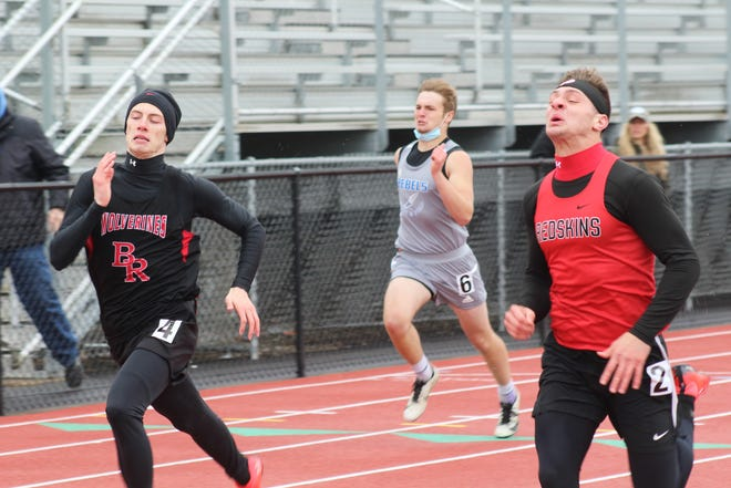 Canisteo-Greenwood's Ryder Slayton, right, edges Bolivar-Richburg's Jason Greeson for a win in the 200 Saturday at Spring Day in Wellsville.
